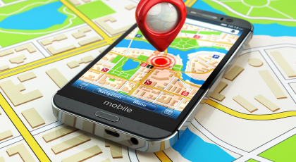 a picture of smartphone on a map with a GPS symbol